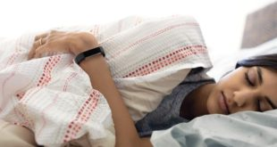 Alta HR lifestyle shot featuring a young Indian woman wearing the black classic band while sleeping.